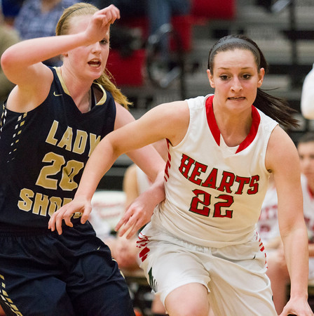 Effingham's Marranda Steffen drives past Teutopolis' Jamie Sandschafer.