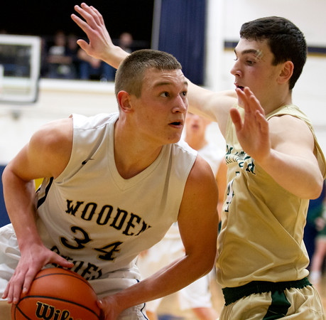 Teutopolis' Mitch Hardiek tries to get around Mattoon's William Courtney Tuesday night. Hardiek would lead the Shoes in scoring with 20.