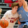 St. Anthony's Chandler Martelli drives the baseline against Breese Mater Dei's Nick Pollmann.
