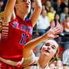 St. Anthony's Abbie Schmidt raises up and over Altamont's Leah Mayhaus during the National Trail Conference championship game.