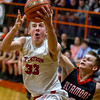 St. Anthony's Drew Gibson eyes the basket after getting past Altamont's Mitchell Stevenson during the second half of the National Trail Conference Tournament championship.