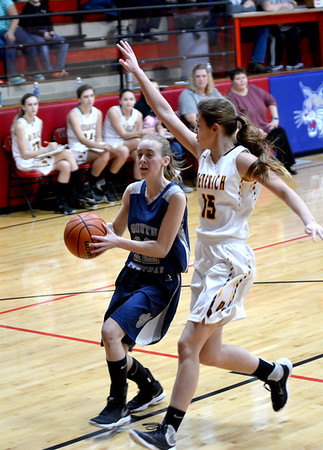 South Central's Deidre Hall drives to the basket against Dieterich's Jennifer Robards during the first game of the National Trail Conference Tournament at Beecher City High School.