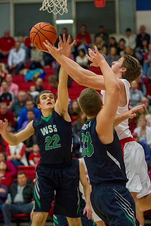 St. Anthony's Alex Beesley goes up and under against Windsor/Stew-Stras' Christian Kessler (22) and Isaac Kramer (33).