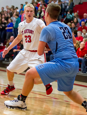 St. Anthony's Jack Nuxoll (left) guards St. Elmo/Brownstown's Dylan Brooks.