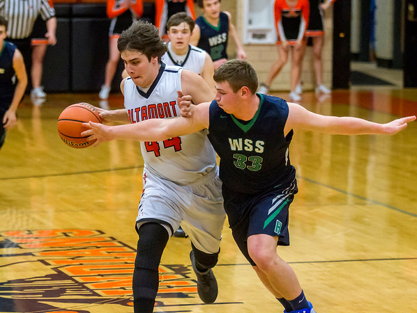 Windsor/Stew-Stras' Isaac Kramer, right, commits a foul after losing possession to Altamont's Evan Cornett Friday during the first quarter of the second NTC Tournament semifinal.