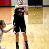 North Clay's Audrey Fleener jumps and throws a pass to the corner in the fifth-place game of the National Trail Conference Tournament against South Central at Beecher City High School.