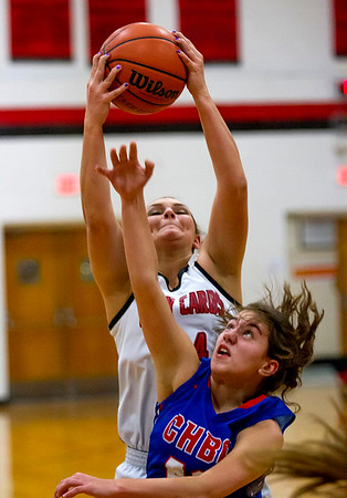 Cowden-Herrick/Beecher City's Tabitha Endsley is outrebounded by North Clay's Maddie Craig.