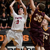 St. Anthony's Cade Walsh drives shoots around the  defense of Dieterich's Callaway Campton (35) and Tyler Higgs (34) during their National Trail Conference Tournament matchup at Altamont High School.<br /> Chet Piotrowski Jr./Piotrowski Studios