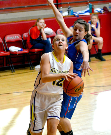 Brownstown/St. Elmo's Deana Shelton drives to the basket in the seventh-place game of the National Trail Conference Tournament against Cowden-Herrick/Beecher City.