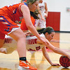Effingham's Bria Barr stretches out and corrals a loose ball in front of Newton's Grace Hartrich at Effingham High School.