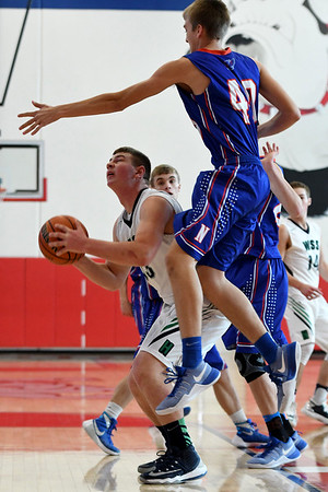 Newton's Nicolas Cohorst attempts to block the shot of W/SS's Isaac Kramer at the Fifth Annual St. Anthony Shootout.<br /> Chet Piotrowski Jr./Piotrowski Studios