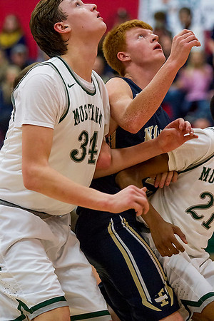 Teutopolis' Lucas Deters tries to box out between Evergreen Park's Mike Drynan, left, and Kyree Hannah, left, at the St. Anthony Shootout.