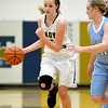Teutopolis' Jolene Bueker brings the ball up court with pressure from Breese Mater Dei's Kelsey Gerdes.