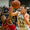Teutopolis' Mitch Hardiek, right, tries to keep control of the ball against Mt. Zion's Kevin Cox.