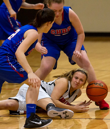 North Clay's Kayle Harmon fights for control of the ball as she is surrounded by Cowen-Herrick/Beecher City's Erica Lorton, left, and Taylor Oldham.