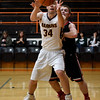 Dieterich's Tyler Higgs takes a pass while being defended by North Clay's Bryce Walker during the opening night of the National Trail Conference Basketball Tournament at Altamont High School.<br /> Chet Piotrowski Jr./Piotrowski Studios