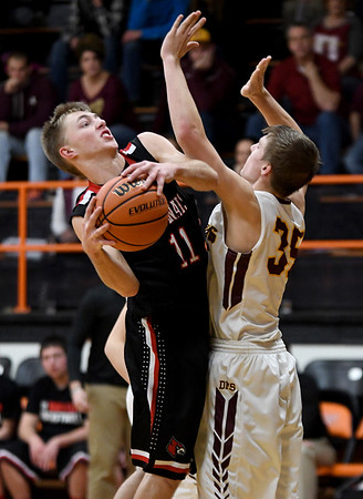 North Clay's Brandon Repking tries to get a shot off against the defense of Dieterich's Callaway Campton during the opening night of the National Trail Conference Basketball Tournament at Altamont High School.<br /> Chet Piotrowski Jr./Piotrowski Studios