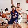 Newton's Michael Koebele dribbles to the basket as W/SS's Isaac Kramer defends him at the Fifth Annual St. Anthony Shootout.<br /> Chet Piotrowski Jr./Piotrowski Studios
