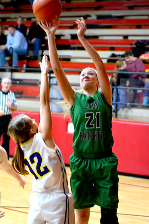 Windsor/Stew-Stras' Megan Schlechte scores over the defense of Brownstown/St. Elmo's Deana Shelton at the National Trail Conference Tournament at Beecher City.