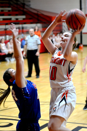 Altamont's Shelbi Stone puts a shot up over the defense of CHBC's Tabitha Endsley at the National Trail Conference Tournament at Beecher City.