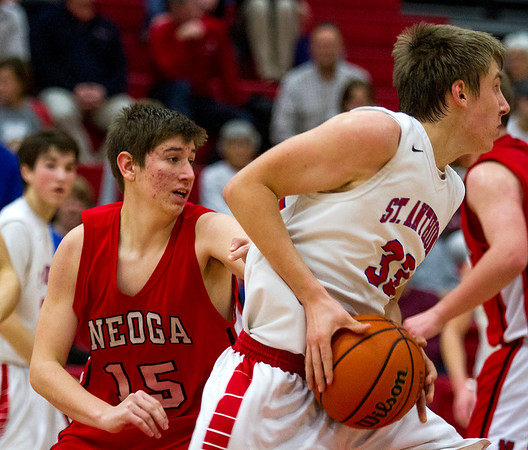 Neoga's Mitchell Cornell, left, loses track of St. Anthony's Drew Gibson during the second quarter. Gibson had 22 points on the night, 14 of which came in the first quarter alone as his Bulldogs bested the Indians 75-34.