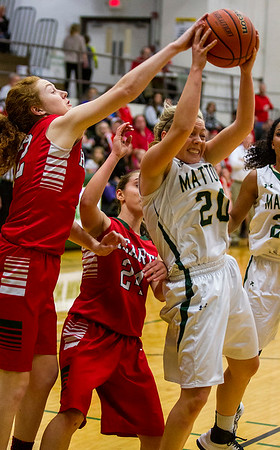 Mattoon's Avery Jackson (20) grabs her own rebound against Effingham's Natalie Carie, left, Thursday night. Jackson's ability to penetrate the lane earned her 23 points in the Green Wave's 53-47 win.