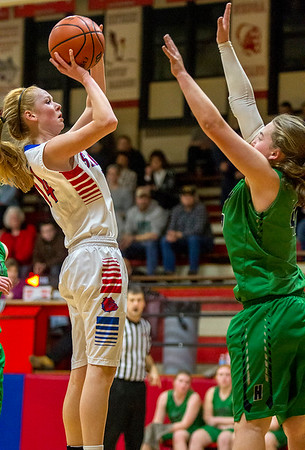 St. Anthony's Clare McHugh pulls up from mid-range against Windsor/Stew-Stras' Nikki Trussell at the National Trail Conference Tournament.