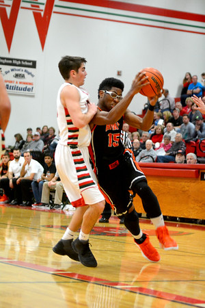 Mt. Vernon's O'Shea Hardin drives past Effingham's Brent Beals during the Rams' loss at Effingham.