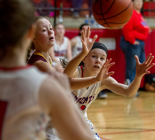 Cowden-Herrick/Beecher City's Jaelyn Robertson, right, tries to grab the inbound pass while Dieterich's Gracie Britton attempts to swipe it away.