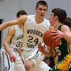 Teutopolis' Eric Kremer (24) defends against St. Thomas More's Tanner Klein.