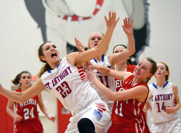 St. Anthony's Olivia Clausius (23) and Neoga's Rachel Ewing (11, red) battle for position for a rebound in the final seconds of St. Anthony's 47-46 win.