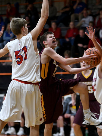 Dieterich's Devin Flach attempts a layup around St. Anthony's Wyatt Lawrence during the National Trail Conference Tournament at Altamont High School.<br /> Chet Piotrowski Jr./Piotrowski Studios