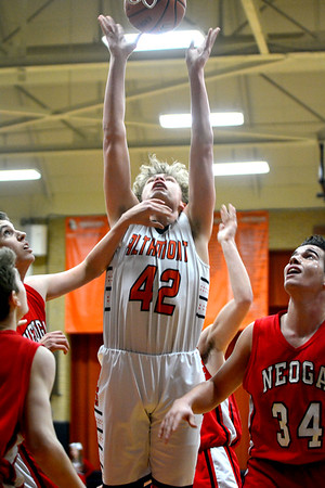 Altamont's Sam Childerson puts up a shot following a rebound while being fouled during a National Trail Conference Tournament game against Neoga.