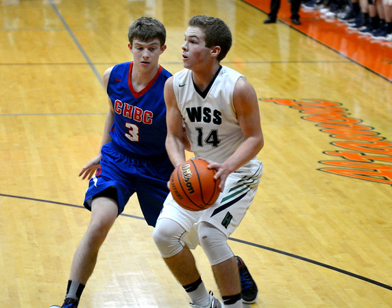 Windsor/Stew-Stras' Nic Hutchinson drives past Cowden-Herrick/Beecher City's Cody Grove and pulls up for a jumper during the National Trail Conference Tournament.