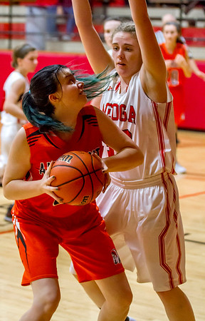 Altamont's Jacie Hosick, left, eyes the basket over Neoga's Ashley Dryden. The bench supplied a much-needed bump for Altamont as they went on to defeat Neoga 68-56 to advance to Saturday's National Trail Conference Tournament championship against St. Anthony.