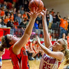 Altamont's Brooke Burns, left, and St. Anthony's Keri McGuire, right, vie for a rebound during the National Trail Conference Tournament championship in Beecher City.