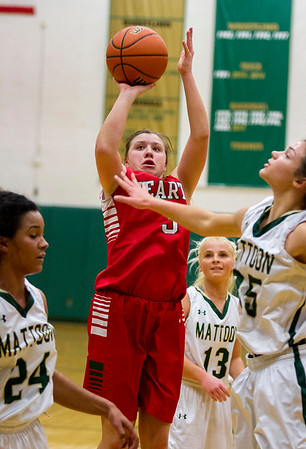 Effingham's Carsyn Fearday pulls up while being surrounded by Mattoon defenders. Despite a tweaked ankle, the sophomore guard led the Hearts in scoring with 20 points.
