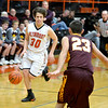 Altamont's Ryan Armstrong runs the fast break while Dieterich's Ryan Radloff sets up defensively.