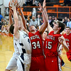 From left, South Central's Ryan McCown, and Neoga's Clayton Butler and Mitchell Cornell reach for a rebound in the final seconds of the seventh-place game of the National Trail Conference Tournament.