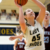 Teutopolis' Claire Bushur grabs an offensive rebound and puts a shot back up against St. Joseph-Ogden.