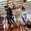 1-3-13<br /> Olivia McClure of Northwestern blocks the shot of Taylor's Lauran Reece during Thursday night's game.<br /> KT photo | Kelly Lafferty