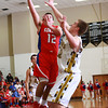 1-4-13<br /> Kokomo vs Peru basketball<br /> Dylan Orbaugh goes up for a basket against Peru's Joe Comerford during Friday night's game.<br /> KT photo | Kelly Lafferty