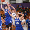 1-8-13<br /> NWHS vs Frankfort bball<br /> Frankfort's Isaac Rudd snatches the rebound during Tuesday night's game against Northwestern.<br /> KT photo | Kelly Lafferty