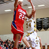 1-4-13<br /> Kokomo vs Peru basketball<br /> Hakim Burnett scores for Kokomo as Peru's Logan Primerano tries to block the shot during Friday night's game.<br /> KT photo | Kelly Lafferty