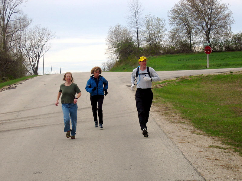 Me, Lorraine Bunk (appropriately dressed as always) and Jason head down the road to the next trail head.