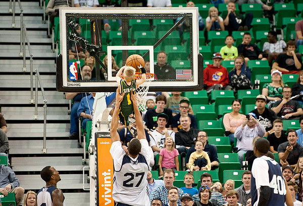 Rudy Gobert picks up JP Gibson to help him slam dunk the ball At Energy Solutions in Salt Lake. On October 6, 2014