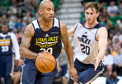 Danhntay Jones #30 drives the ball around Gordon Hayward #20 on Mondays team scrimmage. At Energy Solutions in Salt Lake. On October 6, 2014