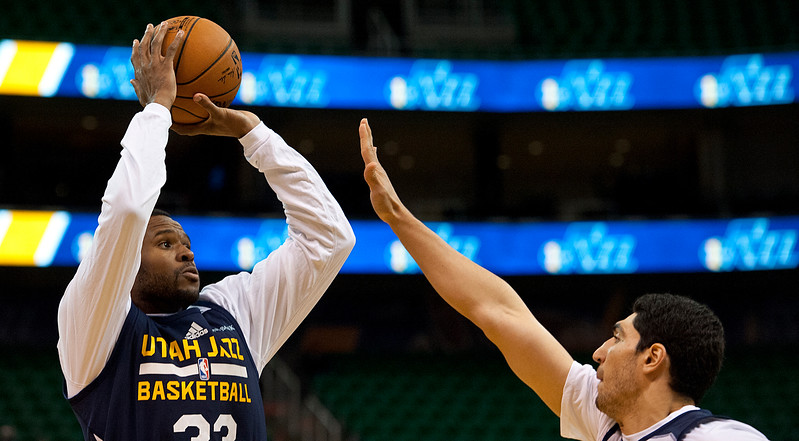 Trevor Booker #33 shoots the ball over Enes Kanter #0 during team Scrimmage. At Energy Solutions in Salt Lake. On October 6, 2014