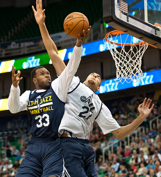 Trevor Booker #33 goes for the up close layup over team mate Rudy  Gobert #27. At Energy Solutions in Salt Lake. On October 6, 2014