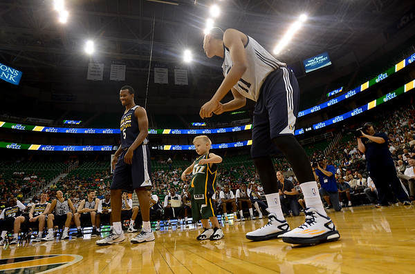 "Rookies Rodney Hood # 5 , Dante Exum # 11 and young JP Gibson do the yearly ""Rookies Dance"". At Energy Solutions in Salt Lake. On October 6, 2014"